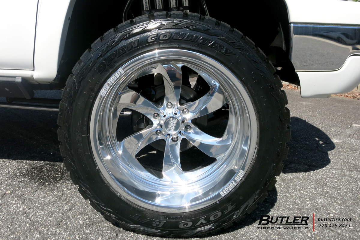 Chevrolet Avalanche with 22in Grid Offroad GF12M Wheels