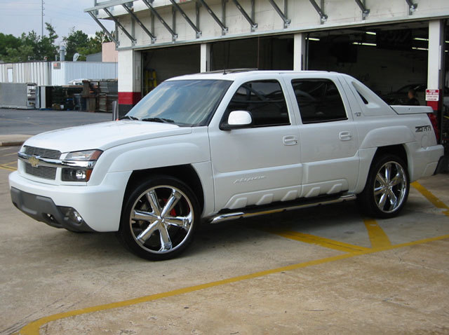 Chevrolet Avalanche with 24in TSW Slugger Wheels