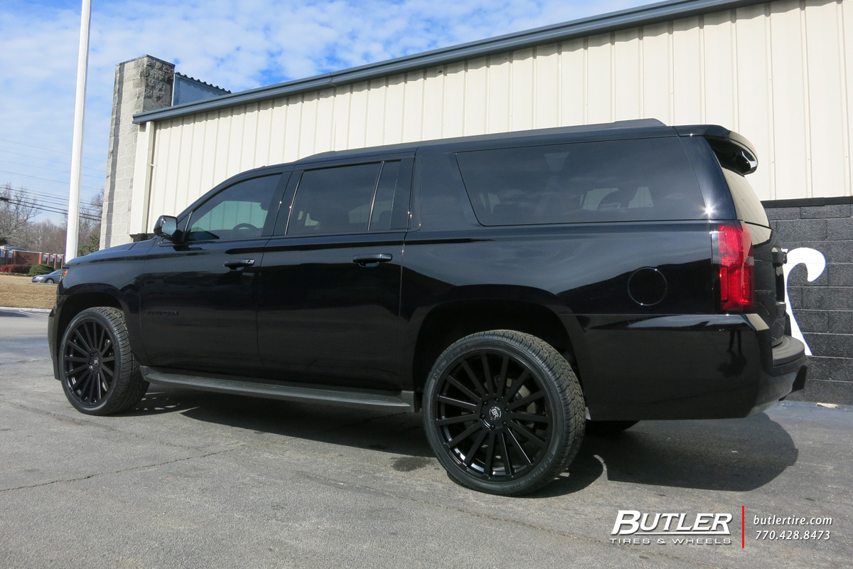 Chevrolet Suburban with 24in Black Rhino Spear Wheels