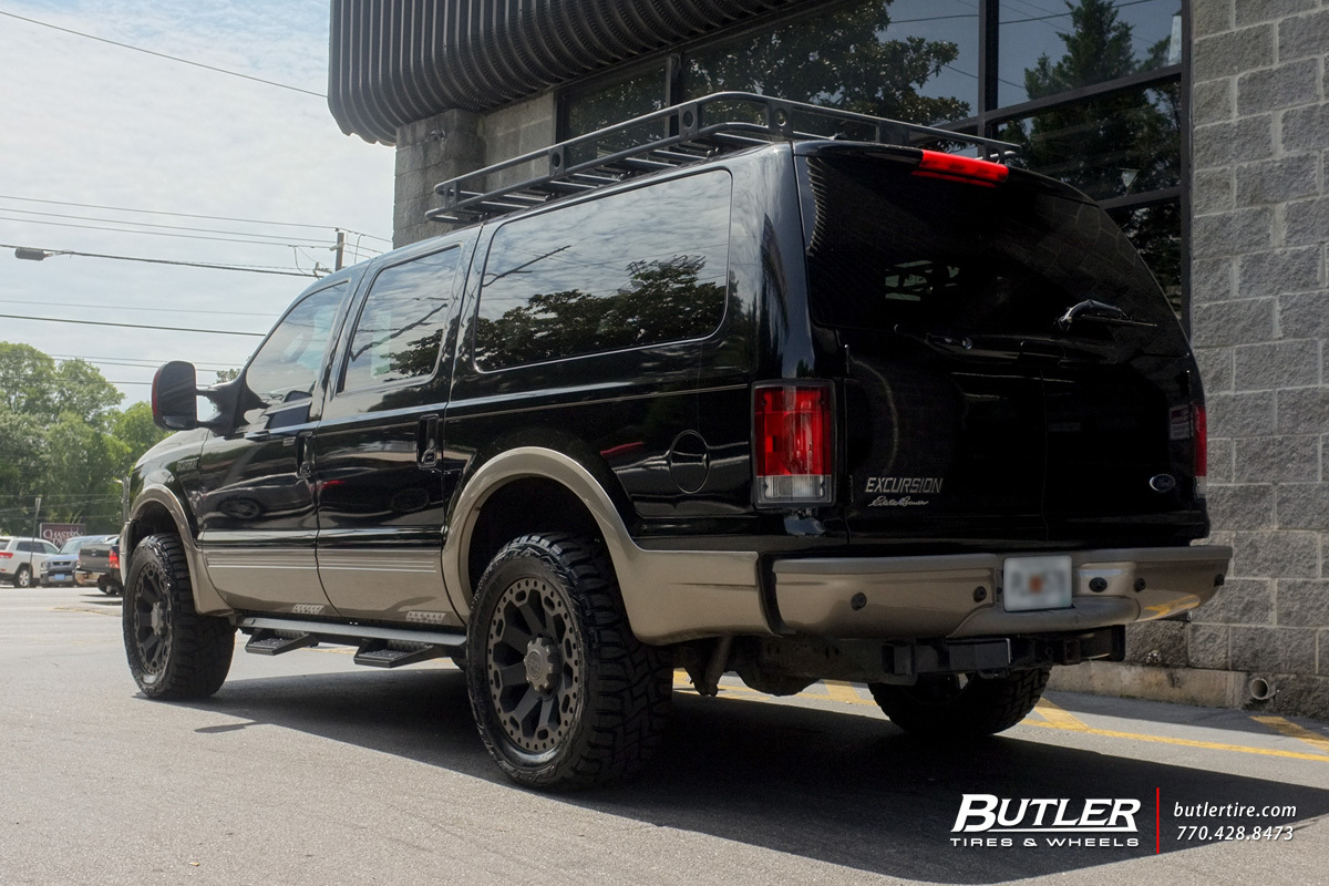 Ford Excursion with 20in Black Rhino Warlord Wheels