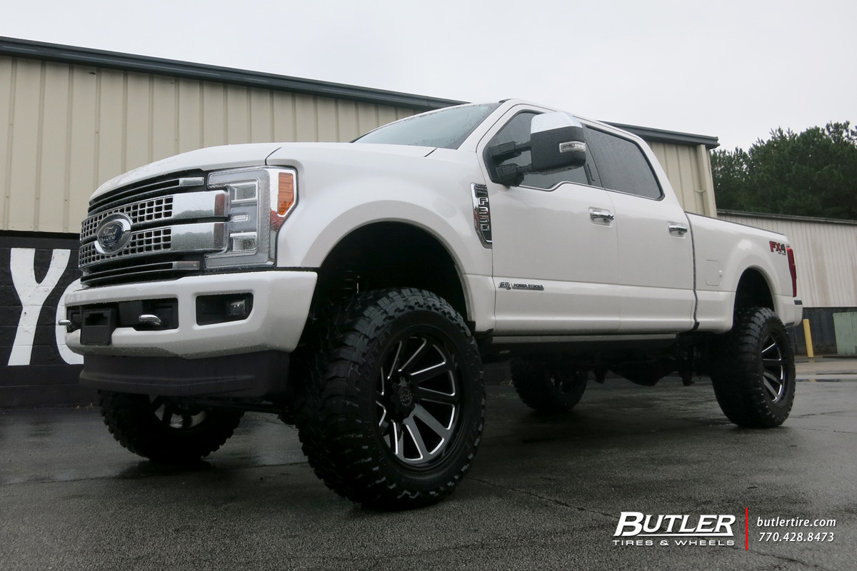 Ford F350 with 22in Black Rhino Thrust Wheels