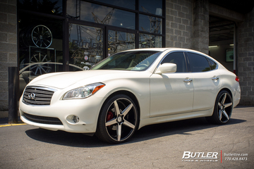Infiniti M56 with 22in Savini BM11 Wheels