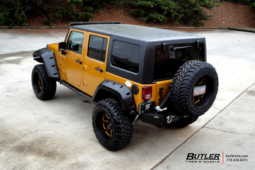 Custom Black and Orange Jeep Rubicon on Black Rhino Glamis Wheels